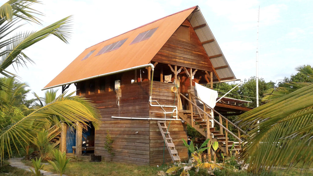 Tropical Wooden Off-Grid Cabin Solar Power Metal Roof