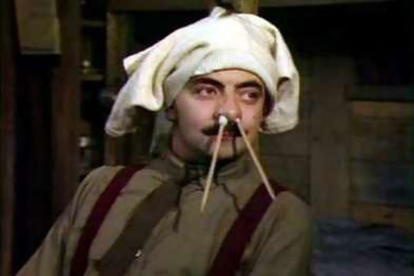 Blackadder with pencils up his nose